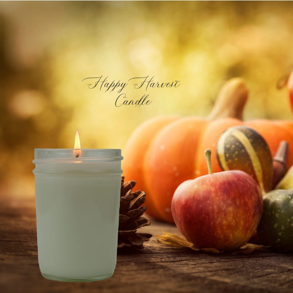 happy harvest candle with lifestyle lighted candle